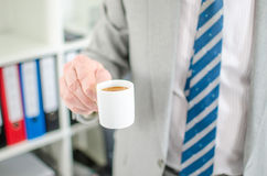 Businessman holding a cup of coffee Royalty Free Stock Photo