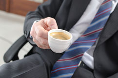 Businessman holding a cup of coffee Royalty Free Stock Images