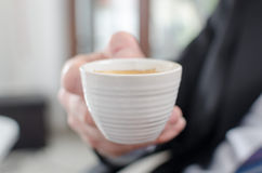 Businessman holding a cup of coffee Stock Photo