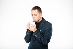 Businessman holding cup with tea Royalty Free Stock Photo