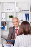 Businessman Holding Cv With Female Candidate At Desk Stock Photography