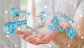 Businessman holding 3D rendering contact icon in his hand. Businessman on blurred background holding 3D rendering contact icon in his hand Stock Images