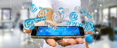 Businessman holding 3D rendering contact icon over his mobile ph. Businessman on blurred background holding 3D rendering contact icon over his mobile phone Stock Photography