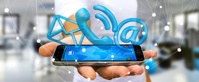 Businessman holding 3D rendering contact icon over his mobile ph. Businessman on blurred background holding 3D rendering contact icon over his mobile phone Royalty Free Stock Images