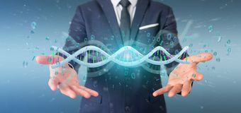 Businessman holding a 3d rendering data coded Dna with binary fi. View of a Businessman holding a 3d rendering data coded Dna with binary file around Royalty Free Stock Images
