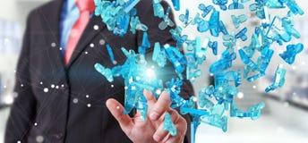 Businessman holding 3D rendering group of blue people. Businessman on blurred background holding 3D rendering group of blue people Royalty Free Stock Images