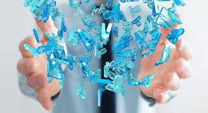 Businessman holding 3D rendering group of blue people Stock Photography