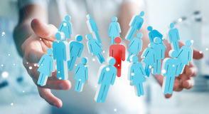 Businessman holding 3D rendering group of people in his hand Royalty Free Stock Images