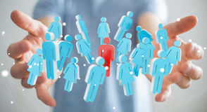 Businessman holding 3D rendering group of people in his hand Royalty Free Stock Photo