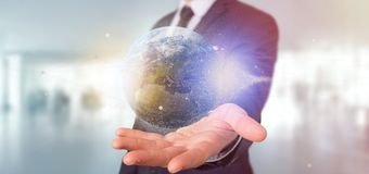 Businessman holding a 3d rendering particles earth globe. View of a Businessman holding a 3d rendering particles earth globe Royalty Free Stock Photos