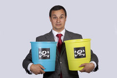 Businessman holding dangerouse buckets Royalty Free Stock Photos