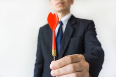 Businessman holding a dart Stock Photo