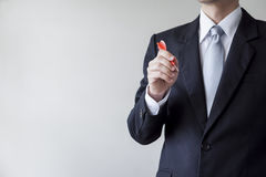 Businessman holding a dart. Business targeting, aiming, focus concept royalty free stock photo