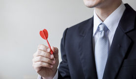 Businessman holding a dart Stock Photos