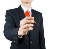 Businessman holding a dart. Business targeting, aiming, focus concept Royalty Free Stock Images