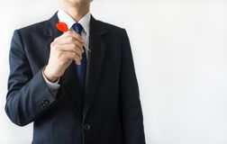 Businessman holding a dart Stock Image