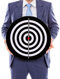 Businessman holding a dartboard Royalty Free Stock Images