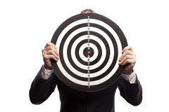 Businessman holding a dartboard Royalty Free Stock Photography
