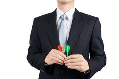 Businessman holding darts. Business targeting, aiming, focus,decision concept Royalty Free Stock Images