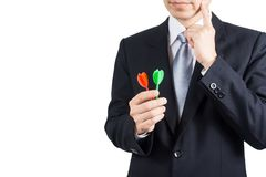 Businessman holding darts. Business targeting, aiming, focus,decision concept Stock Image