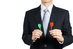 Businessman holding darts. Business targeting, aiming, focus,decision concept Stock Photo