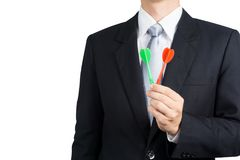 Businessman holding darts. Business targeting, aiming, focus,decision concept Royalty Free Stock Photography