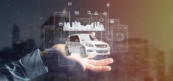 Businessman holding Dashboard smartcar interface with multimedia icon and city map on a background 3d rendering royalty free stock image