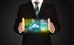 Businessman holding data cloud. Businessman holding a shining data cloud in front of his body Stock Photography