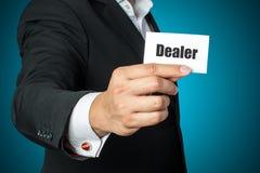 Businessman holding dealer card Royalty Free Stock Images