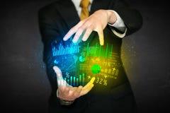 Businessman holding diagram cloud Stock Photos