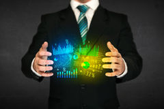 Businessman holding diagram cloud Stock Photography