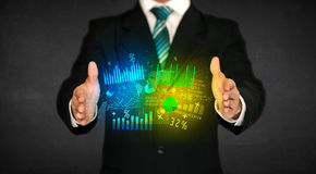 Businessman holding diagram cloud Royalty Free Stock Image