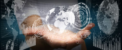 Businessman holding digital charts and globe. Businessman using futuristic screens with world and charts Royalty Free Stock Photo