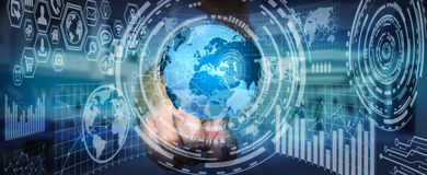 Businessman holding digital charts and globe. Businessman using futuristic screens with world and charts Stock Photo