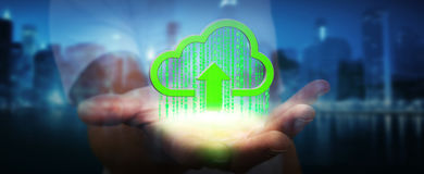 Businessman holding digital cloud in his hand. Green digital cloud receiving datas from businessman hand Royalty Free Stock Photo