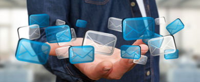 Businessman holding digital email icons '3D rendering'. Businessman holding digital email icons in his hand '3D rendering Royalty Free Stock Images