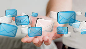 Businessman holding digital email icons '3D rendering'. Businessman holding digital email icons in his hand '3D rendering Royalty Free Stock Photography