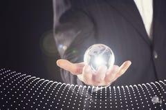 Businessman holding digital globe in palm Royalty Free Stock Photos
