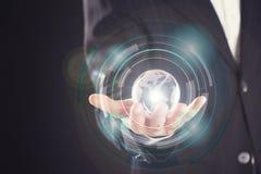 Businessman holding digital globe in palm Stock Photo