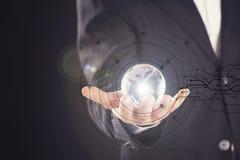 Businessman holding digital globe in palm Stock Photos