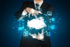 Businessman holding digital icons. Cloud computing concept Stock Photos