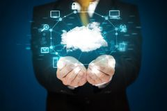 Businessman holding digital icons. Cloud computing concept Stock Photography
