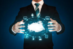 Businessman holding digital icons. Cloud computing concept Stock Photo