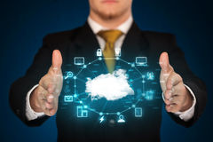 Businessman holding digital icons. Cloud computing concept Stock Images