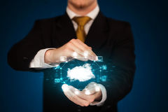 Businessman holding digital icons. Cloud computing concept Royalty Free Stock Image