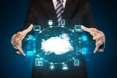 Businessman holding digital icons. Cloud computing concept Royalty Free Stock Photos