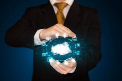 Businessman holding digital icons. Cloud computing concept Royalty Free Stock Photo