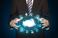 Businessman holding digital icons. Cloud computing concept Royalty Free Stock Photography
