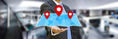 Businessman holding digital map in his hands Stock Photo