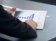 Businessman holding digital tablet Stock Image